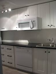 kitchenette with adel off white cabinets and india black galaxy