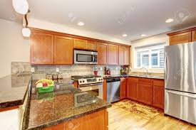 Maple Kitchen Cabinets Maple Kitchen Cabinets With Steel Appliances And Granite Tops