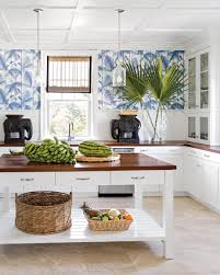 blue palm leaf wallpaper gives this bahamas kitchen a touch of