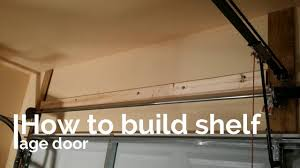 Building Wood Shelves For Storage by How Easy To Build Shelf Storage Above Garage Door Diy Youtube