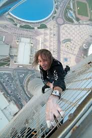 Daredevil climber Alain Robert sets new record for Qatar tower     Alain Robert  the french Spiderman  climbs the tallest building in Qatar
