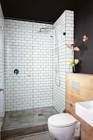 wow so bold with the mix of materials black walls white tiles