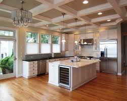 kitchen with exposed beams in the ceiling with hanging lanterns
