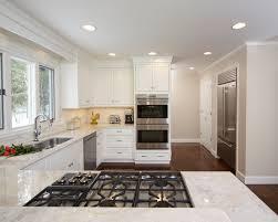 sea pearl quartzite perimeter countertops with white cabinets