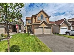 100 how big is a 3 car garage bedroom how much does it cost