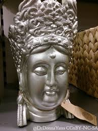 illicit antiquities chic faux decapitated buddha heads as decor