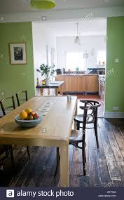 shabby chic kitchen dining room in edwardian terraced house stock