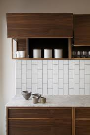 White Subway Tile Backsplash Ideas by Best 25 Walnut Cabinets Ideas On Pinterest Walnut Kitchen