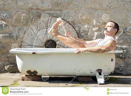 man in the outdoor bathtub stock photo image 63722163