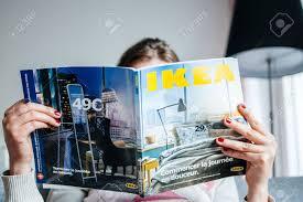 paris france august 24 2014 woman reading ikea catalogue