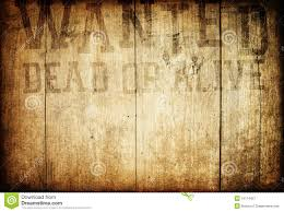 empty wanted poster on weathered plank wood wall stock photo