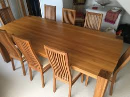 perfect condition solid oak dining table and 8 chairs in
