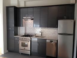 contemporary kitchen with flush light u0026 slate tile floors in new