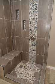 spruce up your shower by adding pebble tile accents click the pin
