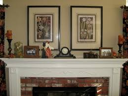 mantel fireplace mantel decor with garlit and lantern for home fireplace mantel decor with clock and frames for interesting home decoration ideas