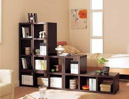 creative idea small room design with dark brown wood shelves