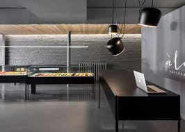 Grey Interior à La Folie Patisserie Contrasts Colourful Treats With A Black And