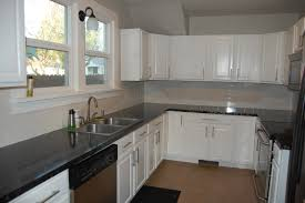 White Kitchen Cabinets With Black Granite Countertops by Kitchen White Oak Kitchen Cabinet 2 Bronze Chandeliers White