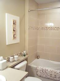 looking good bath mat white tile bathrooms freestanding bath love the 3d wall art and the mosaic tile border in the shower
