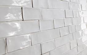 white subway tiles bathroom with white square subway tile and a