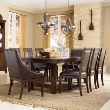 millennium holloway 9 piece extension table set w faux leather millennium holloway 9 piece extension table set w faux leather arm chairs side chairs ahfa dining 7 or more piece set dealer locator