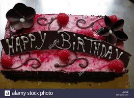 chocolate birthday cake chocolate flower raspberry stock
