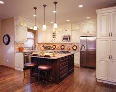 platinum kitchens antique white kitchen with contrasting island