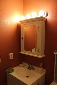 outlet over bathroom mirror with lights to put above medicine