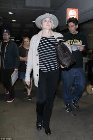 Sign here  Stone was trailed by autograph seekers as she passed through LAX airport on