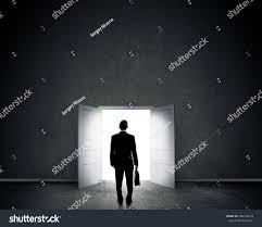 Keyhole Doorway by Silhouette Businessman Briefcase Standing Doorway Stock Photo