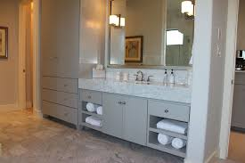 bath cabinets in gray with soco doors and tall towel and linen