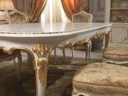 dining table in louis xv style with golden carvings executed by