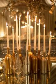 candles placed in wine bottles is a golden 50th birthday