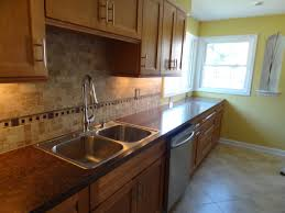 kitchen cabinets design with sink and dishwasher in island