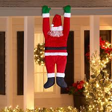 amazon com gemmy outdoor decor santa hanging from gutter patio