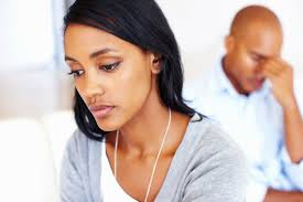 Dating     black African woman Closeup of sad young woman in living room with man after an argument