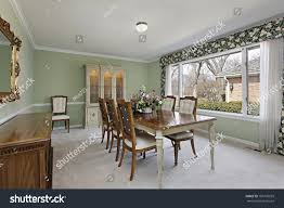 dining room in traditional home with lime green walls stock photo