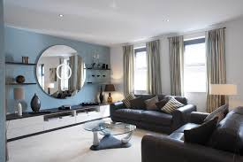 white and blue striped walls light blue curtains and decorative