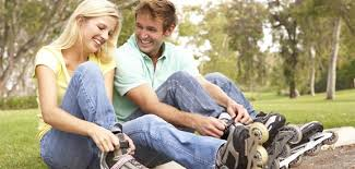 Best  Unique First Date Ideas   What to Do on a Budget Money Crashers roller blading couple