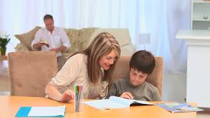 A boy doing his homework with his grandmother in the living room   HD stock video Shutterstock