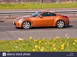 nissan 350z curb weight a nissan 350z fairlady z z33 u201d sports car travelling along the