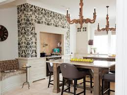 damask wallpaper with antique chandelier and exclusive kitchen