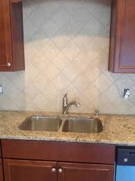 how to lay glass tile backsplash granite countertop riviera