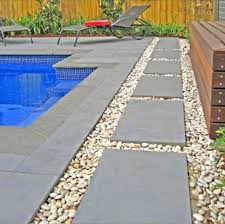 rectangular pool with limestone coping and cobblestone edge and