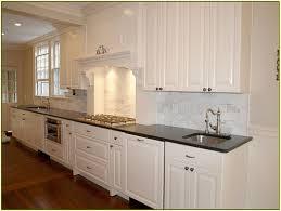 granite countertop mission style cabinet doors stone backsplash