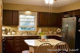 Enamel Kitchen Cabinets by Painting Our Kitchen Cabinets Supplies And Process Beneath My