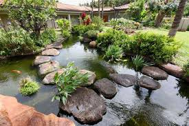 The idea of a pool of water flow in the tropical garden design