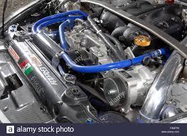 nissan 350z curb weight sports car engine bay nissan 350z tuned car stock photo royalty
