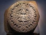 at a wooden Mayan calendar