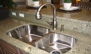granite countertop cabinet door width delta single handle faucet